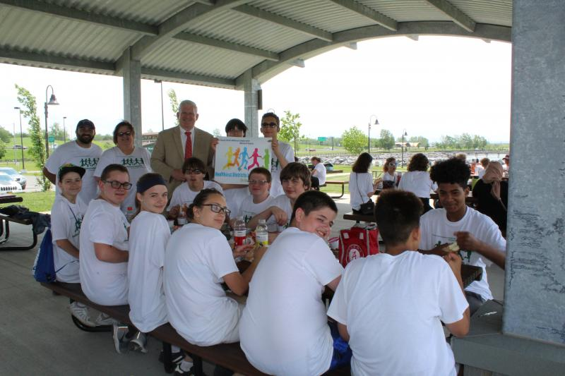 Erie County Clerk Mickey Kearns talks with students from Lackawanna Middle School during the 'Healthy District Initiative Parks Cleanup Day!'.