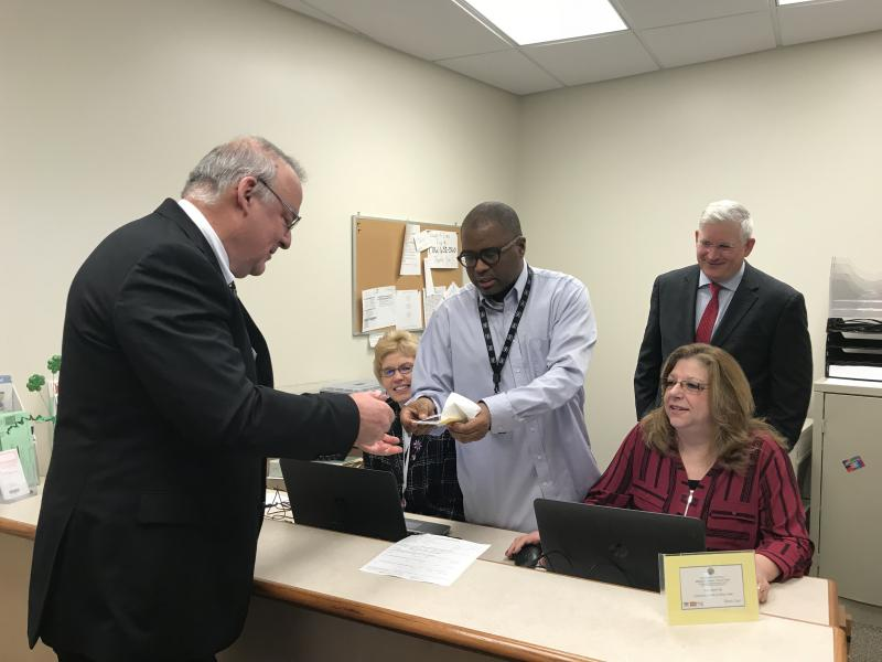 Hon. Judge William Boller conducts first transaction at Elma Pistol Satellite Office