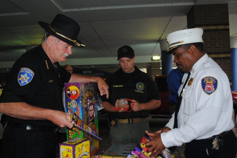Sheriff Tim Howard and others inspect illegal fireworks and homemade incendiary devices