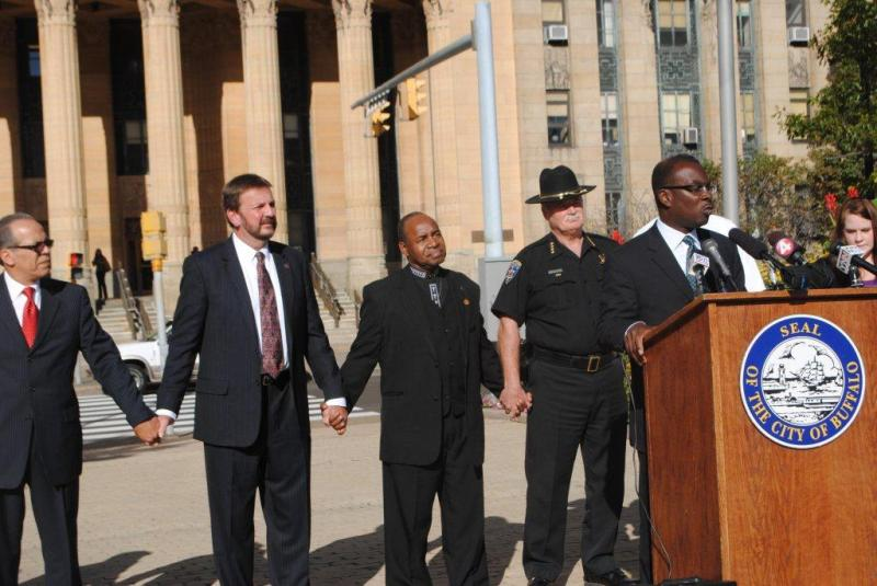 "Sheriff Tim Howard joins Mayor Brown in announcing the ""Hands Across Buffalo Event"""