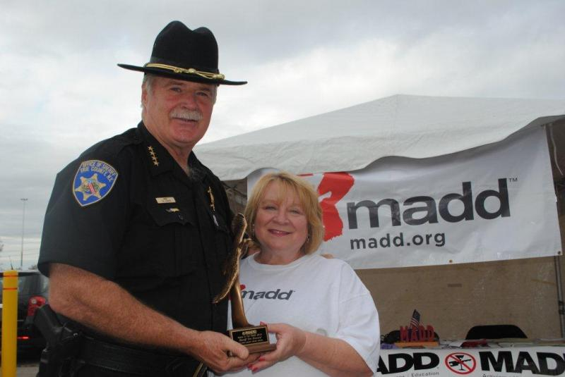 Sheriff Tim Howard receives the Man of the Year Award from MADD